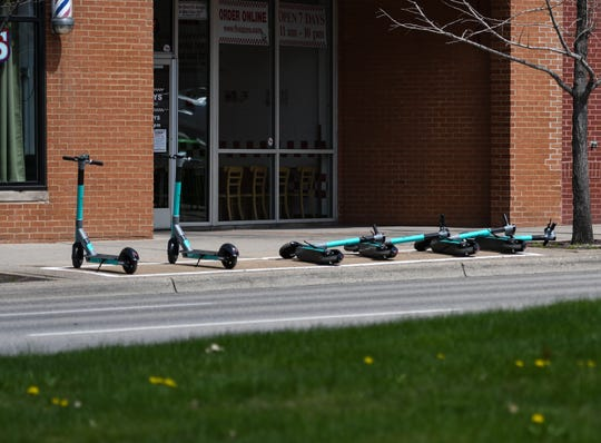 Gotcha electric scooters seen Monday, April 20, 2020, in downtown East Lansing.