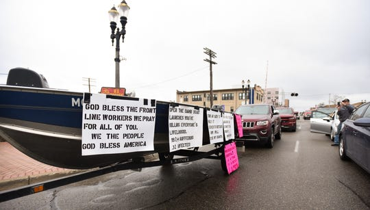 Protesters rally in downtown Lansing Wednesday, April 15, 2020, against Michigan Gov. Gretchen Whitmer's stay-at-home order.