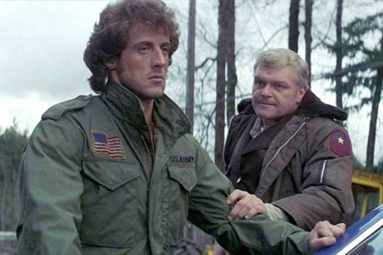 "Sylvester Stalllone and Brian Dennehy in ""First Blood."""