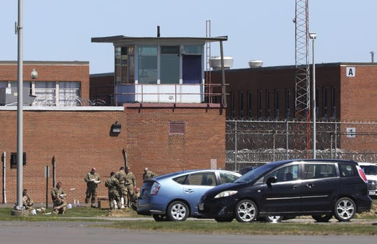 Members of the Ohio National Guard at Marion Correctional Institution, 940 Marion-Williamsport Rd E, Marion, photographed from across the street on Monday, April 20, 2020. The institution has become a hotspot for COVID-19.
