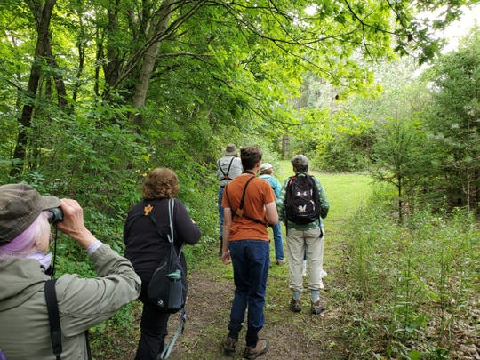 A group of birders led by Jennifer Rutten takes part in a birdwatching outing in the Milwaukee area before the coronavirus pandemic.