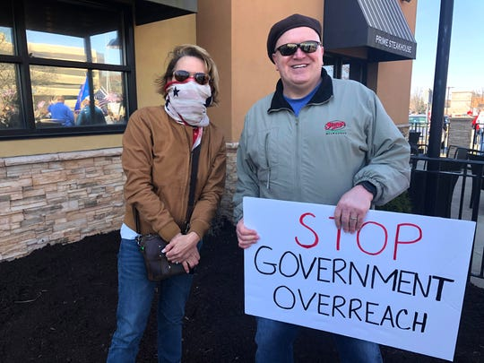 Dale Porter, right, and radio host Vicki McKenna pose for a photo during Saturday's rally in Brookfield.