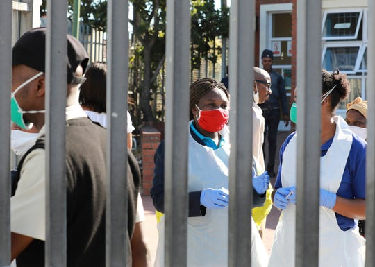 Medical workers prepare to test people for COVID-19 at a testing clinic in Khayelitsha, Cape Town, South Africa on April 2. Doctors fear that the focus on the coronavirus pandemic could waylay efforts to combat other diseases.