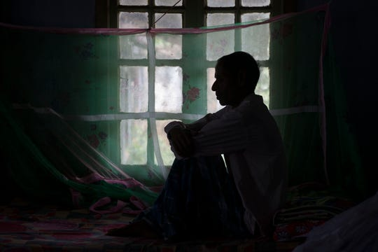 A tuberculosis patient sits on a bed at a TB hospital in Gauhati, India on March 24. Doctors fear that the focus on the coronavirus pandemic could waylay efforts to combat other diseases like tuberculosis, HIV and cholera.