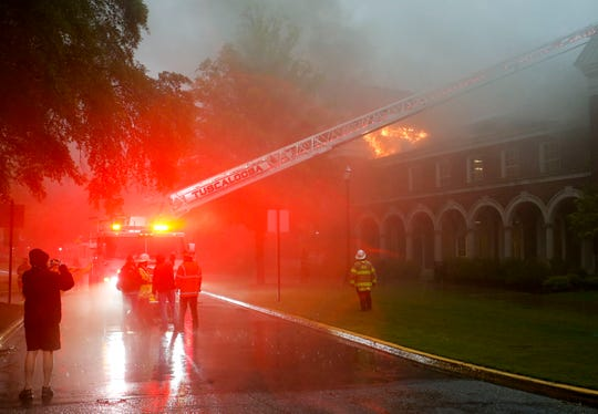 Tuscaloosa firefighters work to control a three alarm fire in the attic space in Moody Music Hall in the wing housing the rehearsal hall for the Million Dollar Band Sunday, April 19, 2020. A series of strong thunderstorms were moving through the city at the time the blaze began but no cause could be determined at the scene. [Staff Photo/Gary Cosby Jr.]