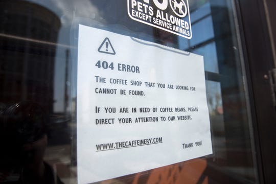 A sign announcing that The Caffeinery was closed in downtown Muncie on Saturday, April 20 was just one of dozens. Businesses have been closed in most capacities since the stay-at-home order from the state in March.