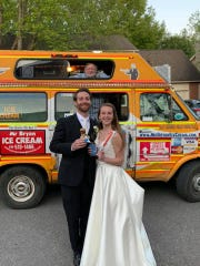 The coronavirus pandemic dashed their initial plans, but Katie and Matthew Lewis still got married on their original wedding date with only 10 people in attendance. Afterward, they celebrated with treats from a passing ice cream truck.
