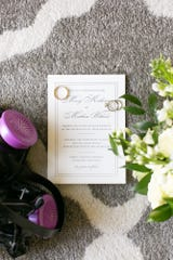 The wedding invitation with a mask added from the Lewis wedding.