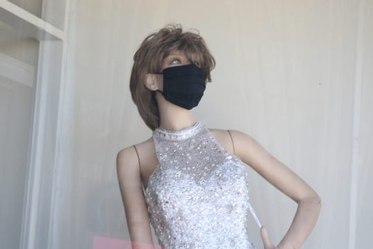 A mannequin at Custom Designers by Gloria in downtown Artesa indicates a sign of the times for Eddy County and the State of New Mexico during COVID-19.