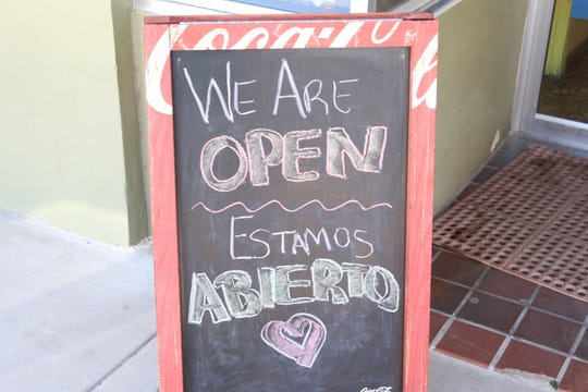 A sign at Restaurante El Dorado in downtown Artesia indicates its open for business on April 20, 2020. Restaurants were deemed essential businesses during a public health edit issued in March, 2020 by the State of New Mexico.