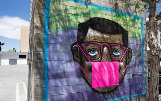 A mural with a face mask is seen in downtown Palm Springs, Calif., on Monday, April 20, 2020.