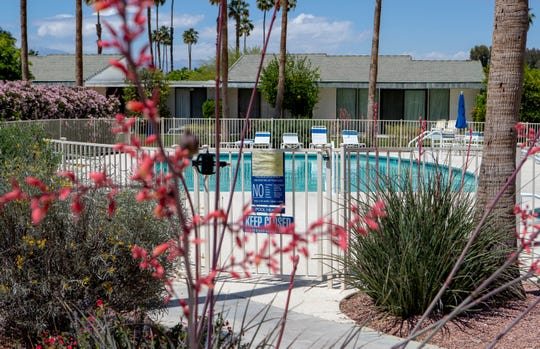 Community pools are devoid of people as they continue to be closed during the stay-at-home orders in Palm Springs, Calif., on Monday, April 20, 2020.