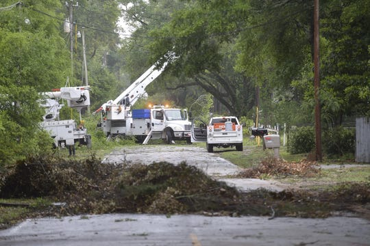 Gulf Power crews are working to restore power to about 6,500 customers still without power on Monday morning following a series of storms that carved a path through the area early Monday morning.