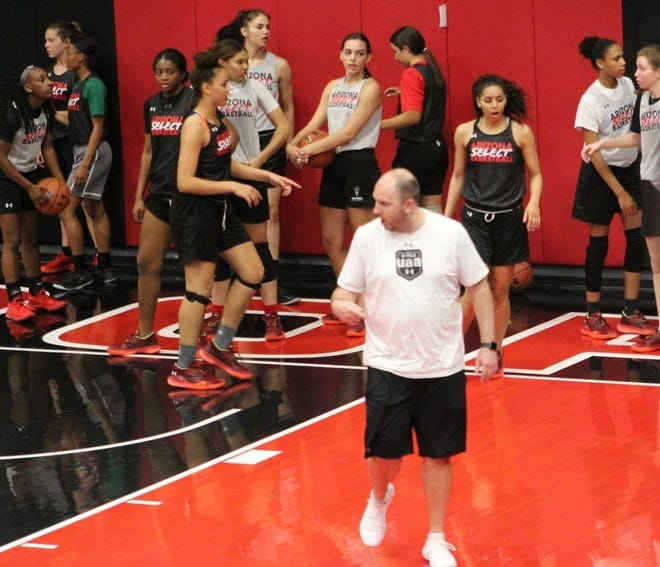 Ben Boyd coaches at his AAU club Arizona Select girls basketball club practice at the PHHacility in Phoenix, Ariz.
