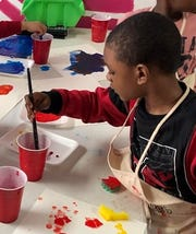 Xavier enjoys the freedom of creating a painting.