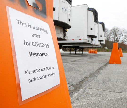 Refrigerated tractor trailers parked at James Baird State Park in LaGrange on April 20, 2020.  Signs near the trailers state that they are at the park as part of a staging area for COVID-19 response.