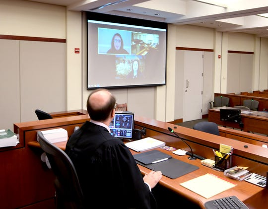 President Judge Joe Adams uses a Zoom video platform for a meeting in a courtroom at the York County Judicial Center Monday, April 20, 2020. Bill Kalina photo