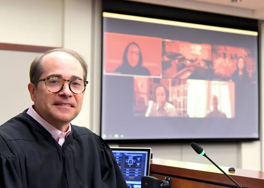York County President Judge Joseph C. Adams shows, Monday, April 20, 2020, the Zoom video set-up he uses in a courtroom at the York County Judicial Center. Bill Kalina photo