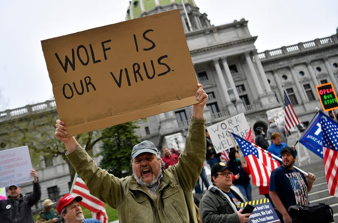 Thousands rally to reopen Pennsylvania in front of the Capitol Building in Harrisburg, Monday, April 20,2020.