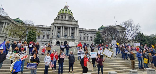 Protesters gathered at the Statehouse Monday, April 20, 2020 for the Reopen PA rally. Photo by John Pavoncello