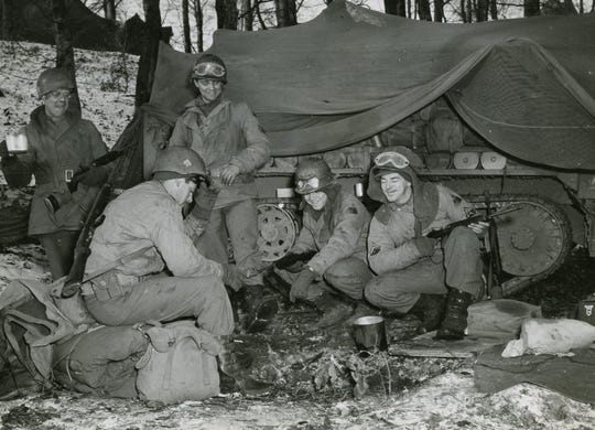 Carl Staab is second from right in photo during a lull in the Battle of the Bulge.