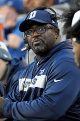 Dallas Cowboys running backs coach Gary Brown looks at the score board during an NFL football game against the Washington Redskins, Sunday, Oct. 21, 2018, in Landover, Md. (AP Photo/Mark Tenally)