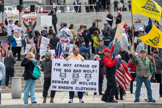 """A """"Reopen Pennsylvania"""" rally in front of Harrisburg's Capitol building drew 2,000 people to hear speakers and show solidarity."""