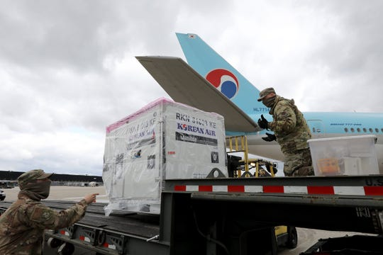 Thousands of COVID-19 test kits from a South Korean company are unloaded on the tarmac at Baltimore/Washington International Thurgood Marshall Airport on Saturday, April 18, 2020.