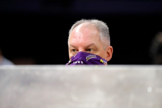 Louisiana Gov. John Bel Edwards wears a mask as he visits a production site on the Louisiana State University  campus, where the school is manufacturing personal protection equipment for hospitals, in response to the coronavirus pandemic, in Baton Rouge, La., Friday, April 17, 2020. (AP Photo/Gerald Herbert)