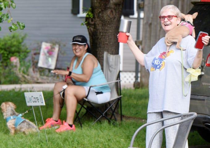 Neighbors meet for the community diner on the 700 block of Delaware Street.