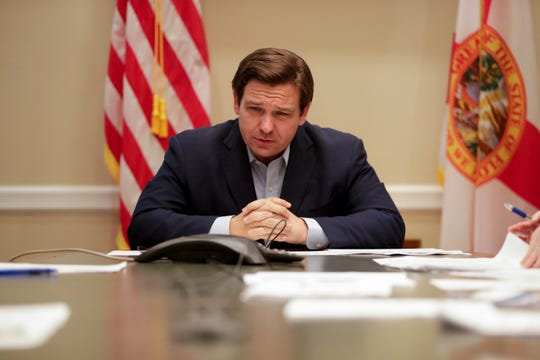 Gov. Ron DeSantis holds a conference call with the Re-Open Florida Task Force at the Capitol Monday, April 20, 2020.
