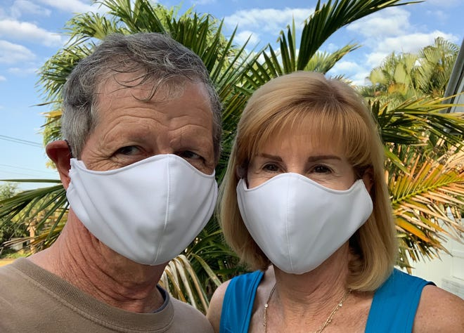 """Larry and Carla Kearns of Jensen Beach wear their homemade masks and don't understand why others aren't protecting themselves and others. """"It's for the benefit of everyone,"""" said Carla Kearns."""