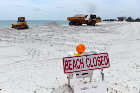 Taking advantage of the beach being closed, construction crews work on beach nourishment on April 20, on the beach south of the Fort Pierce South Jetty in Fort Pierce.