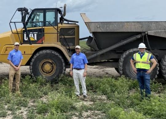 Standing Monday, April 20, 2020, at the site of the Everglades Agricultural Area Reservoir Project are (from left) South Florida Water Management District Executive Director Drew Bartlett, district board Chairman Chauncey Goss and Tim Harper, the project's construction manager.