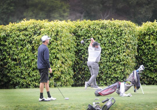 A golfer hits a tee shot on the first hole at Los Robles Greens Golf Course in Thousand Oaks on Monday. County golf courses were allowed to reopen with restrictions, which include no motorized carts.