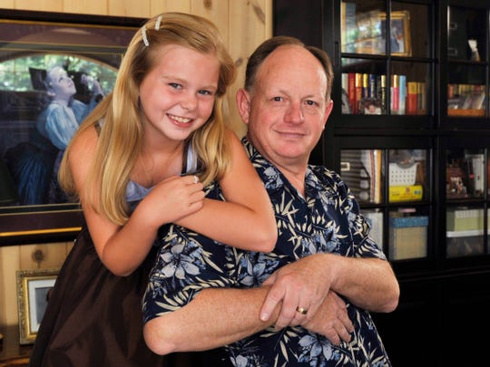 Colleen Busby, then 9, with her father Bruce Busby in this 2008 file photo.