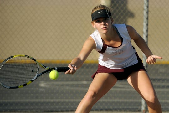 In this 2014 file photo, Colleen Busby, pictured,  competes in a tennis match for Mt. Whitney High School.