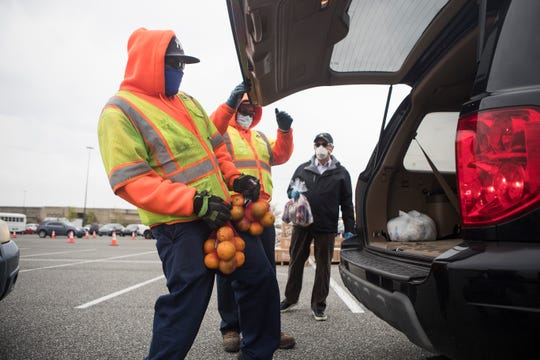 The Food Bank of Delaware holds a drive-thru mobile pantry to help feed Delaware residents during the coronavirus pandemic at the Christiana Mall Monday, April 20, 2020, in Newark.