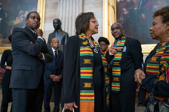 In this Oct. 24, 2019, file photo members of the Congressional Black Caucus gather for a memorial ceremony for the late Maryland Rep. Elijah Cummings, at the Capitol in Washington. From left are Rep. Joe Neguse, D-Colo., Rep. John Lewis, D-Ga., Rep. Robin Kelly, D-Ill., Rep. Gwen Moore, D-Wis., Rep. Gregory Meeks, D-N.Y., and Rep. Barbara Lee, D-Calif. The Congressional Black Caucus PAC is endorsing Joe Biden's presidential bid, further cementing his support among the nation's influential black political leadership.