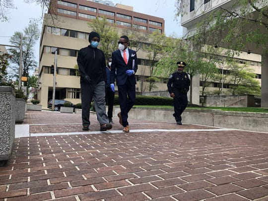 """Federal fugitive Richard Cephas (left) is being escorted to the federal courthouse in Wilmington on Monday afternoon by Rev. Derrick """"Pastor D."""" Johnson."""