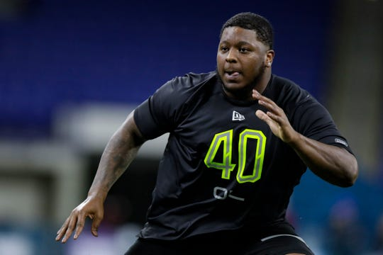 Michigan offensive lineman Cesar Ruiz runs a drill at the NFL football scouting combine in Indianapolis, Friday, Feb. 28, 2020. (AP Photo/Michael Conroy)