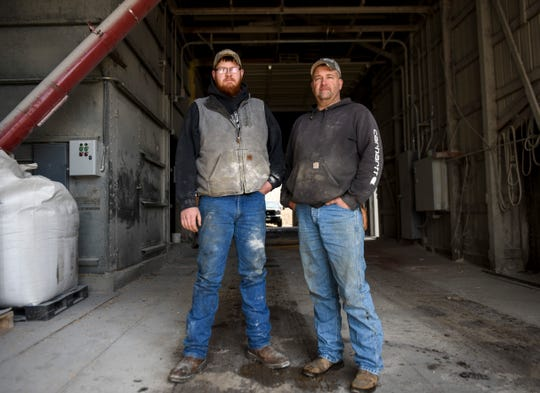 Mike Ver Steeg and his son Cody Ver Steeg pose for a portrait at Prestige Pork, Tuesday, April 14, 2020, in Inwood, Iowa. Ver Steeg, who sells around 75% of his hogs to Smithfield, is concerned with what he'll do with that stock now as he experiences the effects of the coronavirus. (Abigail Dollins/The Argus Leader via AP)