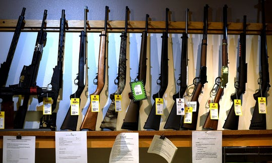 Gun dealers were urged to be patient as the FBI works on background checks.