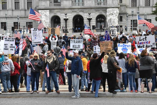 """People take part in a """"reopen"""" Pennsylvania demonstration on April 20, 2020 in Harrisburg, Pennsylvania."""