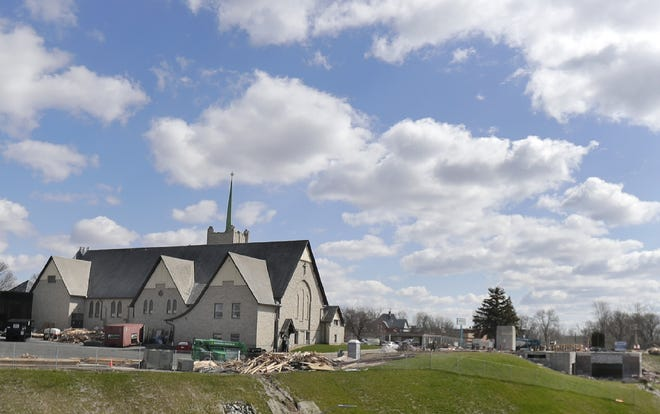Appleton and U.S. Venture are negotiating terms for the redevelopment of the bluff sites, including the former Trinity Lutheran Church, left, and former Fox Banquets and Rivertyme Catering, right.