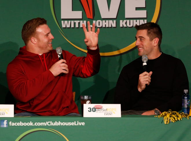 Green Bay Packers quarterback Aaron Rodgers (right) hangs out with then-fullback and teammate John Kuhn on the Dec. 1, 2014, episode of Clubhouse Live. The show was held in the Red Lion Hotel Paper Valley's Grand Ballroom in downtown Appleton.