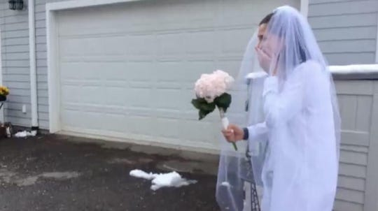 Megan Musa's friends and family surprised her as she married Kevin Moore in the driveway of her mother's home on  April 18, 2020.