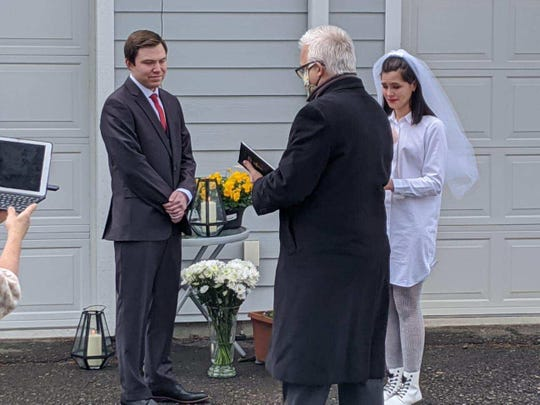 Kevin Moore and Megan Musa were married in the driveway of Musa's mother's home on April 18, 2020.