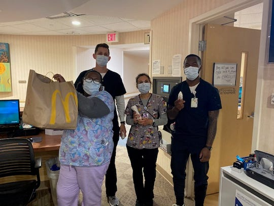 That staff at Parrish Medical Center in Titusville accepts breakfast from McDonald's.