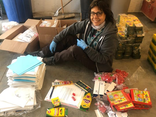 Arista Alanis, Johnson Elementary School art teacher and Vermont Studio Center's Community Arts Coordinator, assembles more than 200 emergency art kits to send to students to inspire creativity at home while remote learning, early April 2020.